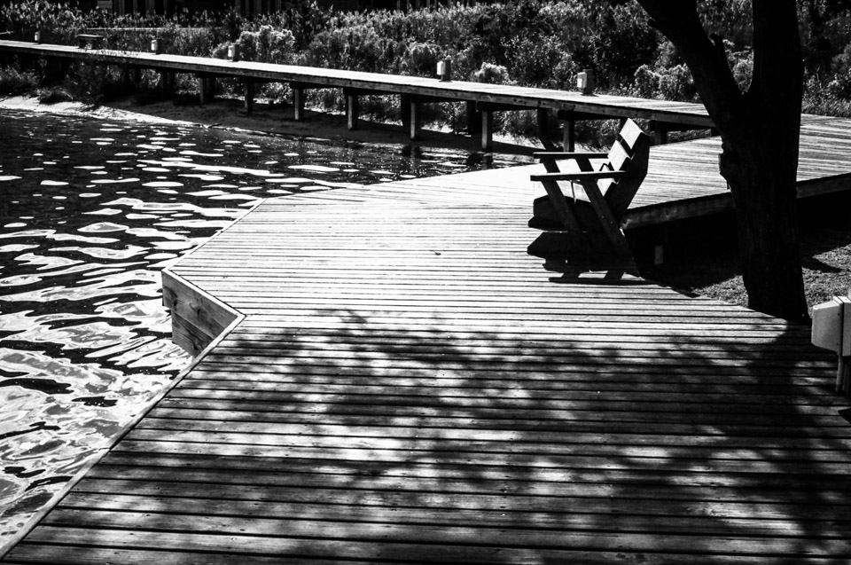 A bench on the boardwalk in Manteo, North Carolina
